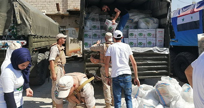 俄軍人在敘利亞實施人道主義行動