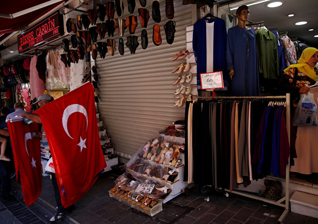 Women shop for clothes at Mahmutpasa street, a popular middle-class shopping district, in Istanbul