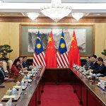 中国帮助马来西亚克服金融困难