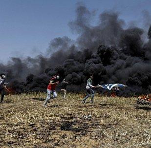 巴勒斯坦人与以色列军队在加沙冲突(资料图片)