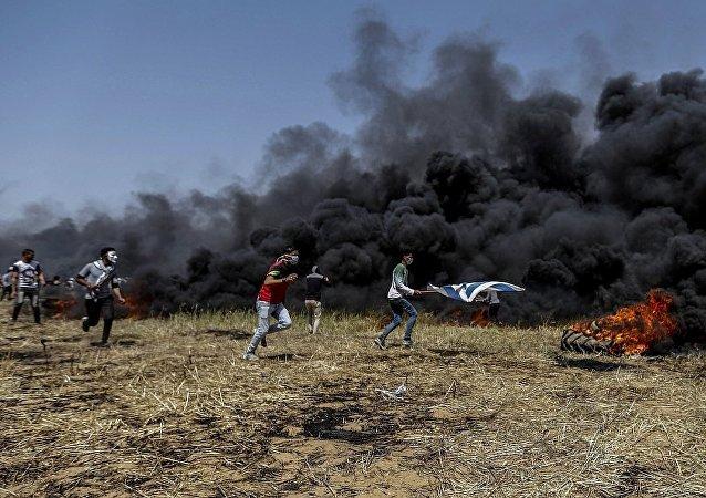 巴勒斯坦人與以色列軍隊在加沙衝突(資料圖片)