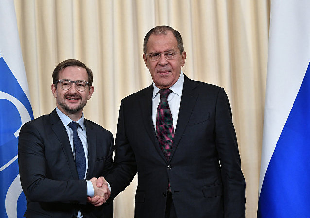 謝爾蓋•拉夫羅夫與托馬斯•格雷明格(資料圖片)