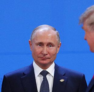Президент России Владимир Путин и президент США Дональд Трамп на саммите G20 в Аргентине.