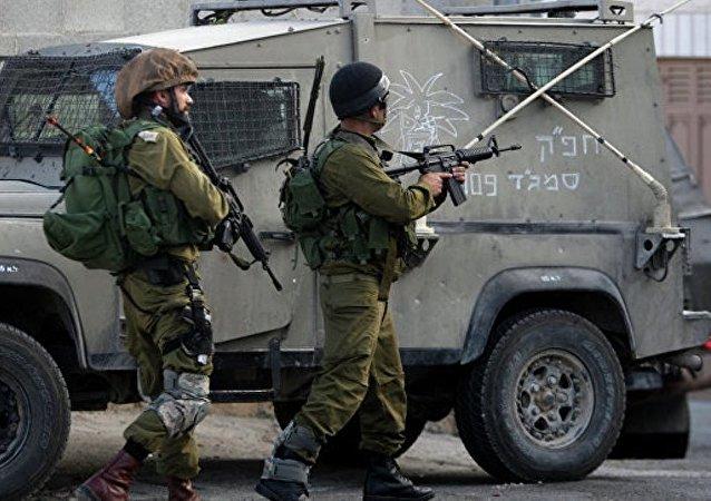 以军:以色列展开摧毁真主党渗入本国隧道的行动