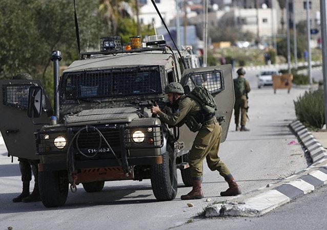 以色列军方在巴勒斯坦拉姆安拉郊区发生恐袭后封锁该市
