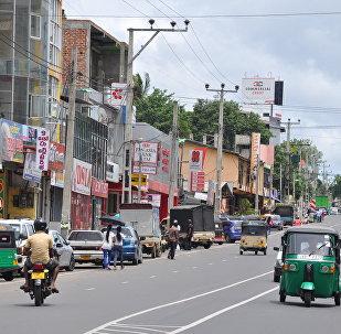 中国将帮助斯里兰卡在国际债权人面前保留面子