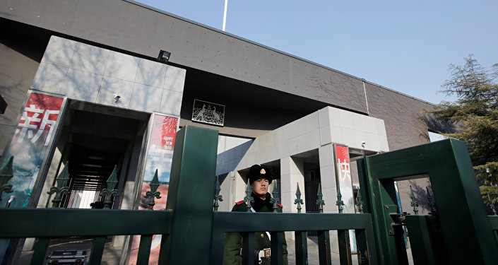 A paramilitary policeman stands guard at the Australian embassy in Beijing, China January 24, 2019.