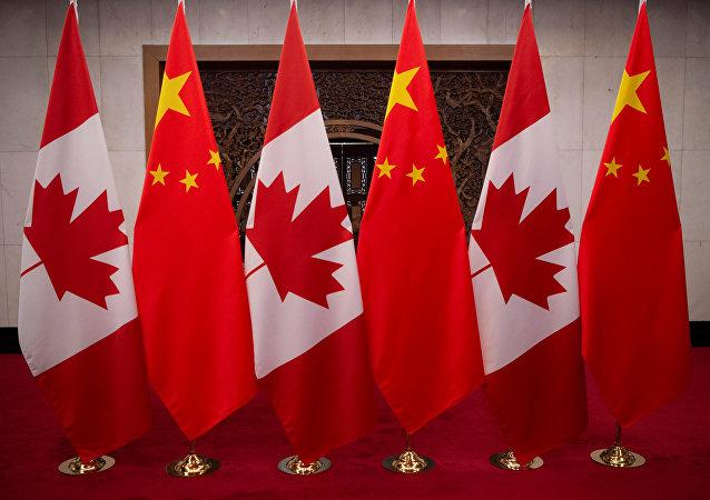 加拿大求美国帮助解决与中国的关系