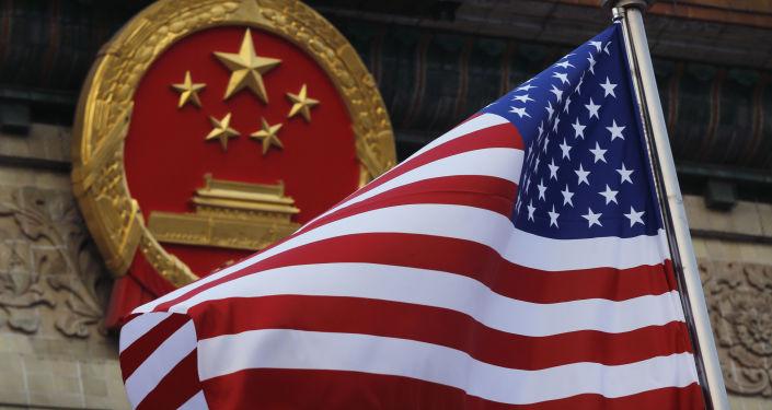 IMF:中美贸易战阻碍全球经济增长 但两国有望达成协议