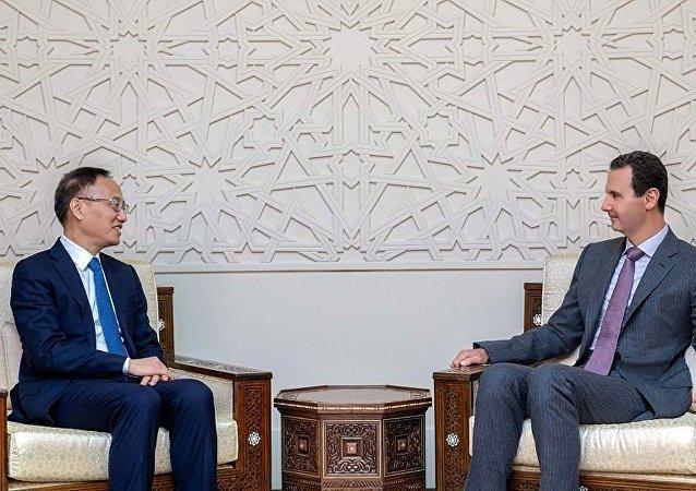 敘利亞總統阿薩德和中國外長助理陳曉東(資料圖片)