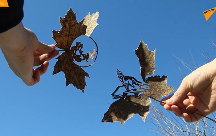 哈薩克藝術家在落葉上作畫
