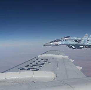 俄羅斯國防部發布一段紹伊古在敘上空飛行視頻