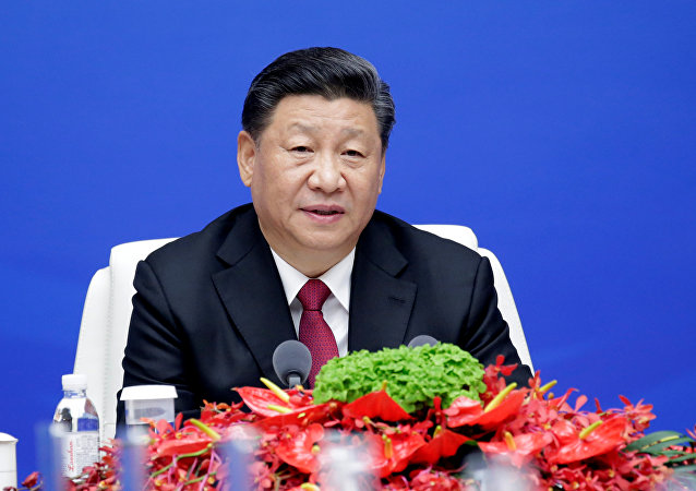 Chinese President Xi Jinping speaks during a meeting with international navy delegates to mark the 70th anniversary of the founding of the Chinese People's Liberation Army Navy in Qingdao