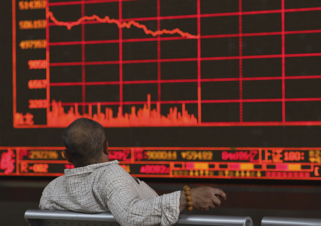 A Chinese investor watches as the Shanghai Composite Index falls at a brokerage In Beijing on Monday, May 6, 2019.
