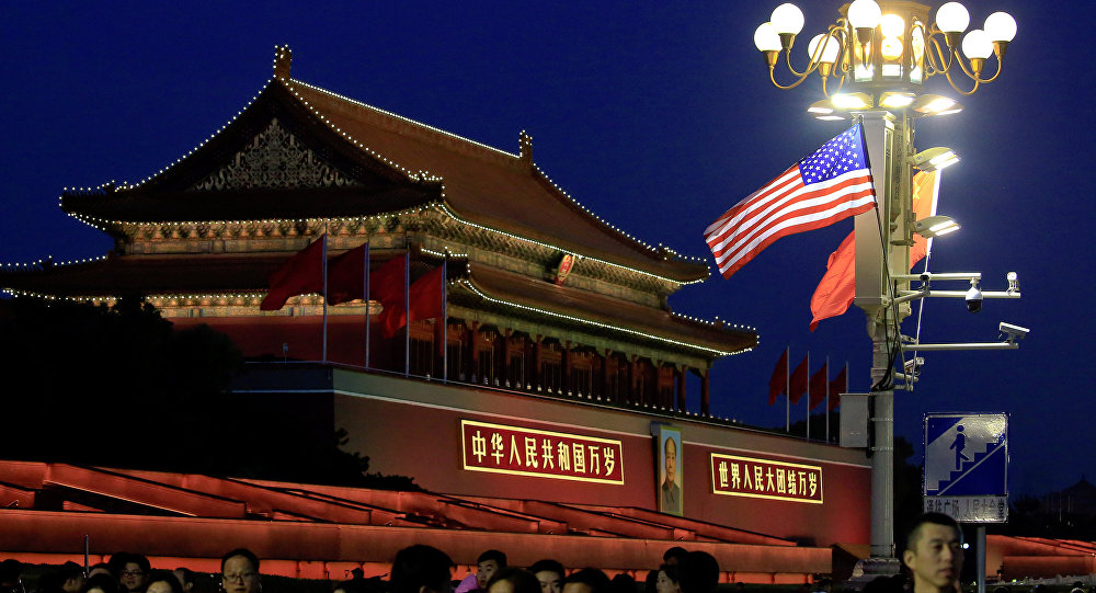 People walk under U.S. and China's flags at the Forbidden City during the visit by U.S. President Donald Trump in Beijing