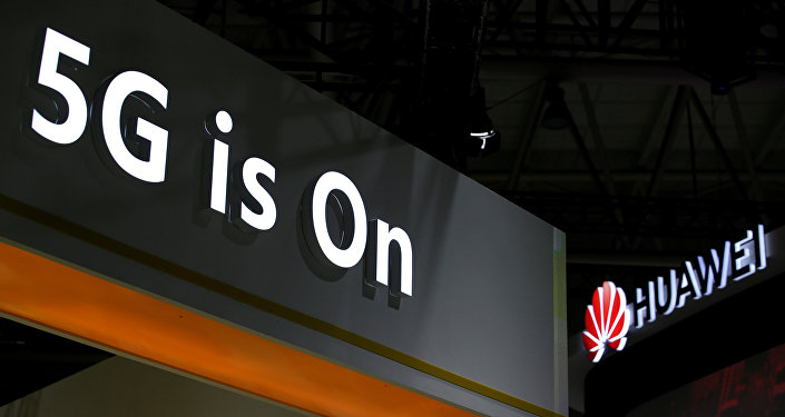 A Huawei logo is seen at an exhibition during the World Intelligence Congress in Tianjin