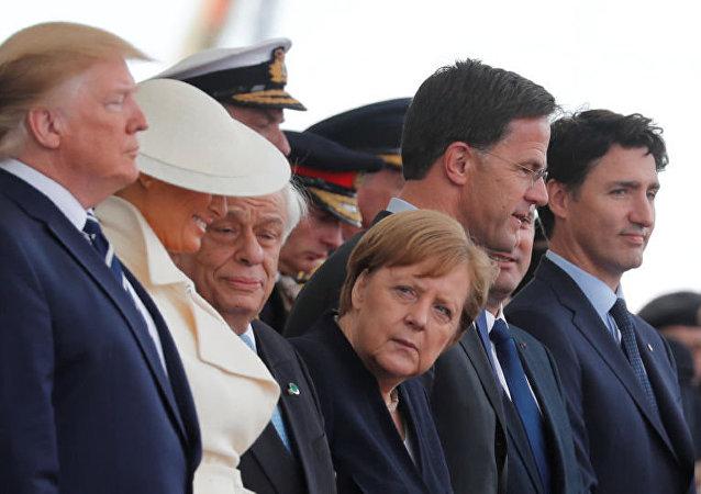 冰冷的諾曼底會議:特朗普無視默克爾 默克爾活像「女學生」