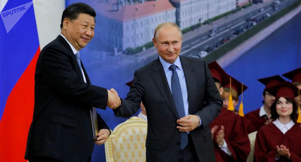《中国国家主席习近平访问俄罗斯成果总结》莫斯科-北京视频连线会