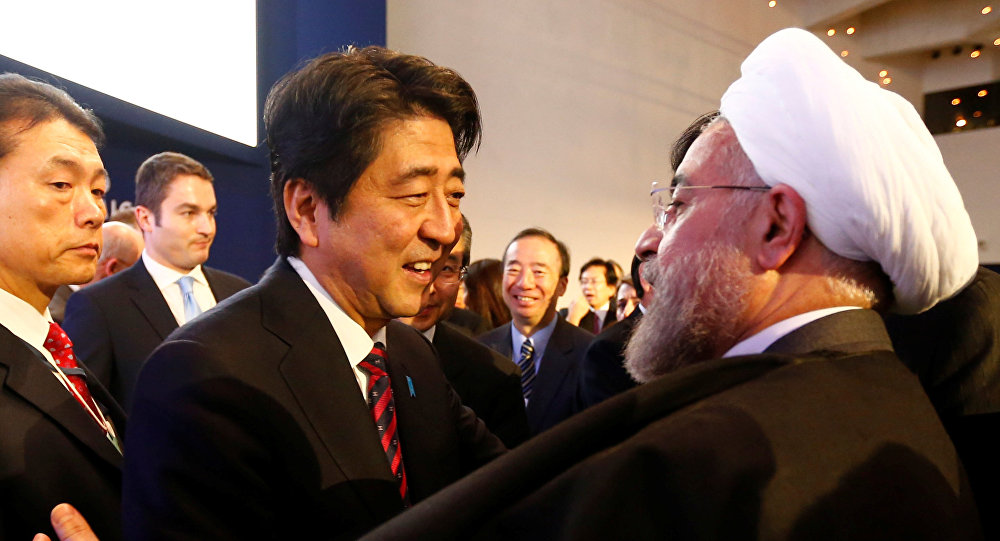 Japan's Prime Minister Abe greets Iran's President Rouhani at World Economic Forum in Davos