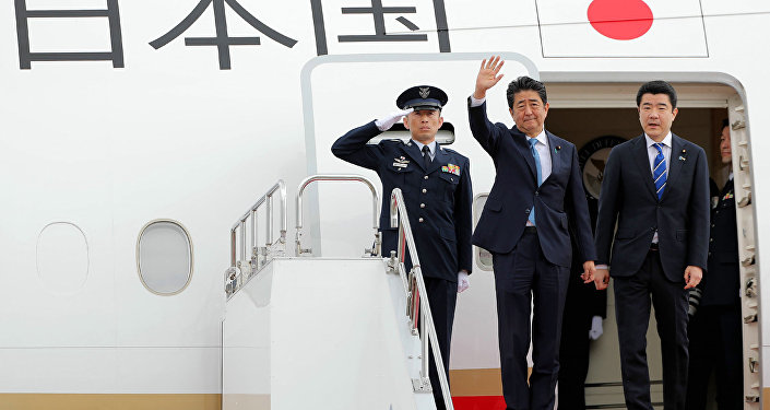 Japan's Prime Minister Shinzo Abe  waves to well-wishers upon his departure at Tokyo's Haneda Airport on June 12, 2019. Abe left for a two-day visit to Iran.