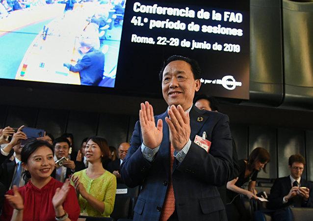 Заместитель министра сельского хозяйства и сельских дел КНР Цюй Дунъюй