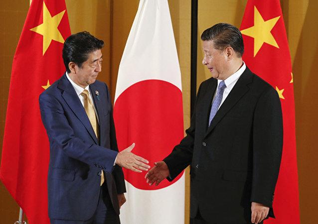 國家主席習近平當地時間27日在大阪會見日本首相安倍晉三