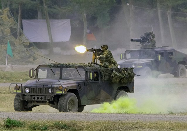 Army soldiers demonstrate their combat skills at a military base in southern Pingtung, Taiwan
