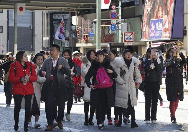 Китайские туристы в Токио