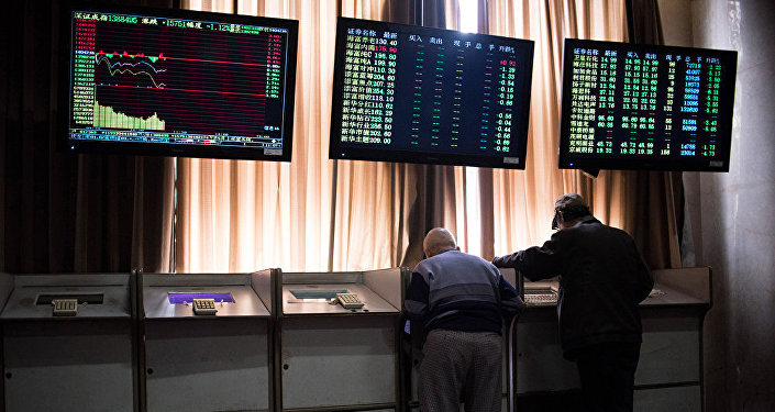 Chinese investors look at prices of shares and the Shanghai Composite Index at a stock brokerage house