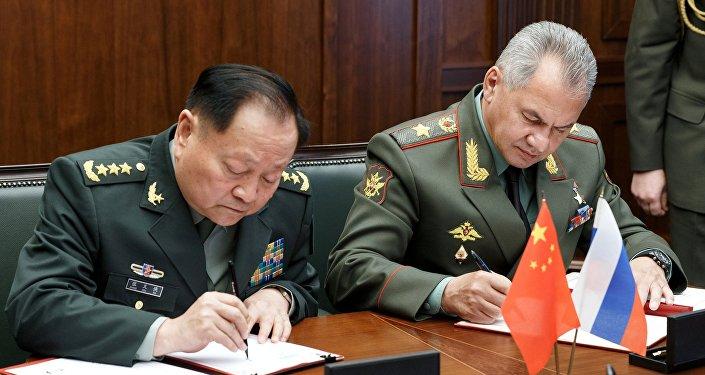 Министр обороны РФ С.Шойгу встретился с заместителем председателя Центрального военного совета КНР Чжан Юсем