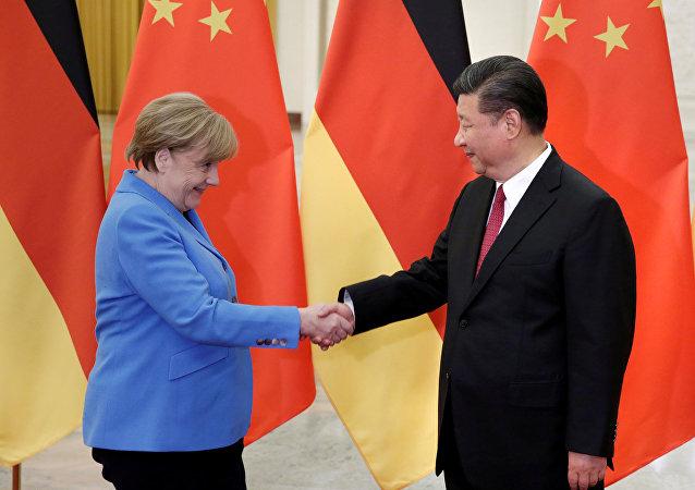 習近平承諾默克爾中國經濟將繼續開放