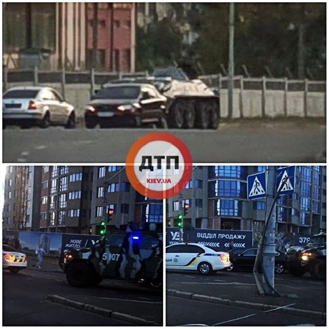以装甲运兵车为首的车队开上基辅大桥,朝威胁要炸桥的男子行驶