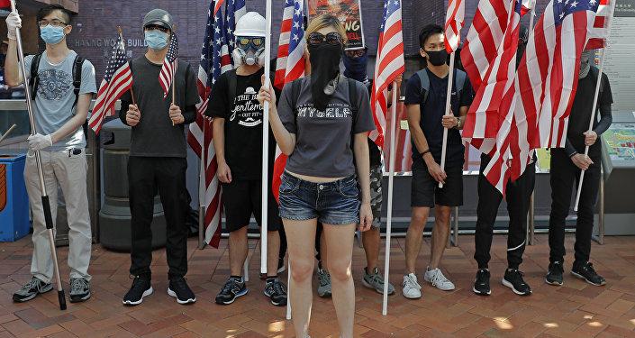 Гонконг протесты США маски